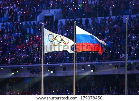 Sochi, RUSSIA - February 23, 2014: Olympic and Russian flag at closing ceremony in Fisht Olympic Stadium at the Sochi 2014 Olympic Games - stock photo