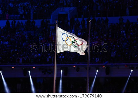 Sochi, RUSSIA - February 23, 2014: Olympic flag at closing ceremony in Fisht Olympic Stadium at the Sochi 2014 Olympic Games - stock photo