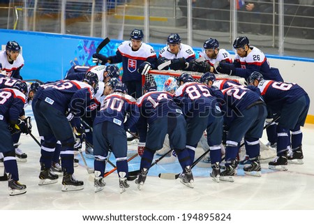 Sochi, RUSSIA - February 18, 2014: Slovakia team players on ice at start of Ice hockey Men's Play-offs Qualifications Game vs. Czech team at the Sochi 2014 Olympic Games - stock photo