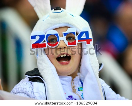Sochi, RUSSIA - February 19, 2014: Supporters at Ladies' 5000 m Speed Skating at the Sochi 2014 Olympic Games - stock photo