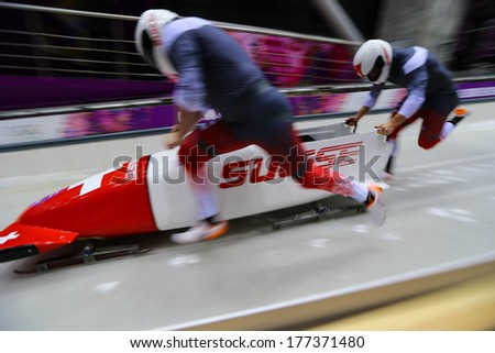 Sochi, RUSSIA - February 16, 2014: Switzerland 2 team at two-man bobsleigh heat at Sochi 2014 XXII Olympic Winter Games - stock photo