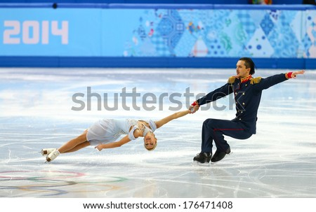Sochi, RUSSIA - February 11, 2014: Tatiana VOLOSOZHAR and Maxim TRANKOV (RUS) on ice during figure skating competition of pairs in short program at Sochi 2014 XXII Olympic Winter Games - stock photo
