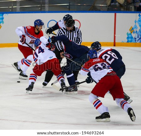 Sochi, RUSSIA - February 18, 2014: Tomas PLEKANEC (CZE) on ice during Ice hockey Men's Play-offs Qualifications Game vs. Slovakia team at the Sochi 2014 Olympic Games - stock photo