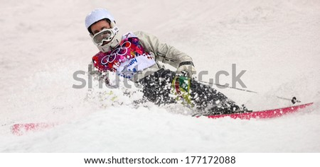 Sochi, RUSSIA - February 10, 2014: Unidentified athlete at Freestyle skiing. Men's Moguls Qualification at Sochi 2014 XXII Olympic Winter Games - stock photo
