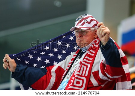 Sochi, RUSSIA - February 18, 2014: US supporter at Ladies' 3000 m Heats Short Track Relay Heats at the Sochi 2014 Olympic Games - stock photo