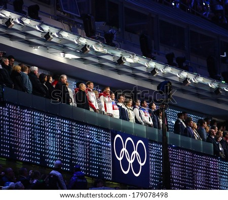 Sochi, RUSSIA - February 23, 2014: Vladimir Putin, Tomas Bach and other authorities at closing Ceremony in Fisht Olympic Stadium at the Sochi 2014 Olympic Games - stock photo