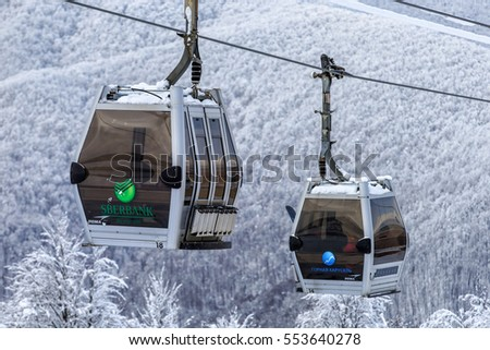 Sochi, Russia - January 9, 2015: Cable car ski lifts in Gorky Gorod winter mountain ski resort host ski and snowboard riders all winter long. Two cabins on snowy background close up view