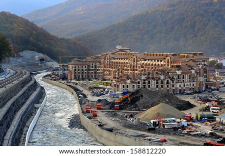 SOCHI, RUSSIA - JULY 10: Construction of mountain Media Village on July 10, 2013 in Sochi, Russia. In the period of the Olympic Games will work here 4 thousand journalists. - stock photo