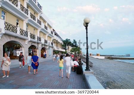 SOCHI RUSSIA  JUNE 10 2015. Main seaside promenade in the evening - stock photo