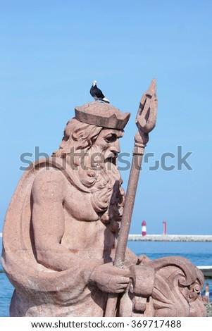 SOCHI RUSSIA  JUNE 11 2015. Sculpture of the sea god Neptune at a seafront promenade - stock photo