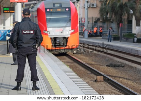 SOCHI, RUSSIA - MAR, 3, 2014: The police officer patrols the railway station Hosta. Increased security measures because of the Olympic winter games - stock photo