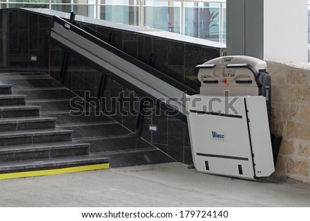SOCHI, RUSSIA - MAR 03, 2014: The special Elevator for the disabled at the entrance to the hotel - equipment for successful Paralympic winter games - stock photo