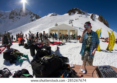 SOCHI, RUSSIA - MARCH 22, 2014: Party in the ski resort, MC entertains tourists - stock photo