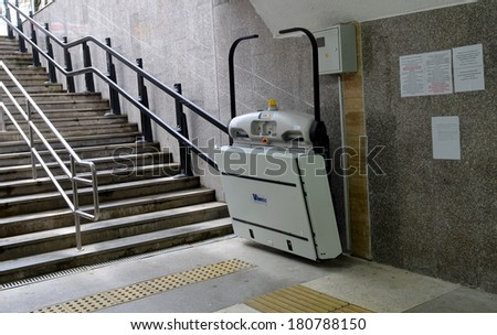 SOCHI, RUSSIA - MARCH 05, 2014: Underpass, equipped with special lifting platform for wheelchair users for successful Paralympic winter games  - stock photo
