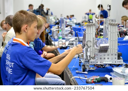 SOCHI, RUSSIA - November 21, 2014: Children make a robot at the robot Olympiad in Sochi . Here there was the World Robotic Olympiad 2014. It was attended by delegates from 47 countries.