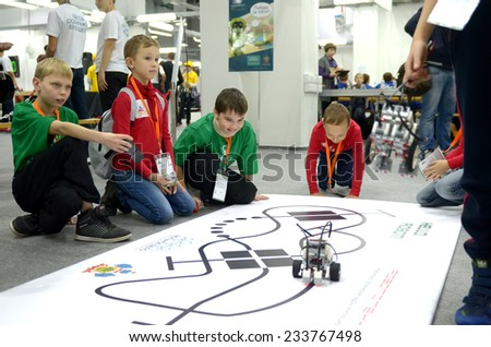 SOCHI, RUSSIA - November 21, 2014: Childrens of Team Russia at the robot Olympiad in Sochi. Here there was the World Robotic Olympiad 2014 - stock photo