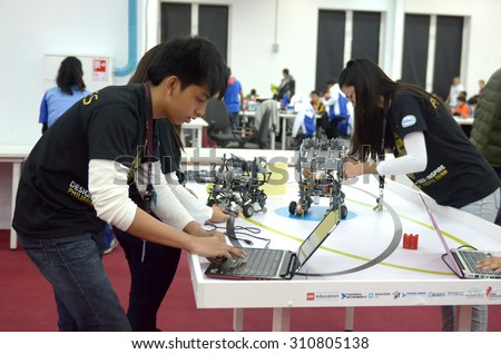 SOCHI, RUSSIA - November 21, 2014: Philippines team at the robot Olympiad in Sochi . Here there was the World Robotic Olympiad 2014. It was attended by delegates from 47 countries. - stock photo