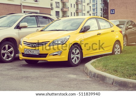 Sochi, Russia - October 11, 2016: New yellow Hyundai Solaris (Accent) parked on the street of Sochi.