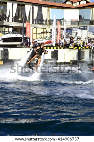 Sochi, Russia, on 2 may 2016. Open, free show of yachts and boats. The performance of the man on a water jet pack. The show is devoted to holiday of spring and peace. Only for editorial