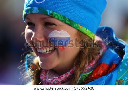 Sochi, RUSSIA - Unidentified volunteer girl at ladies' Skiathlon 7.5 km Classic + 7.5 km Free of Sochi 2014 XXII Olympic Winter Games - stock photo