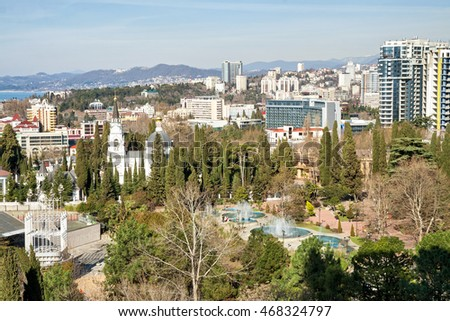 Sochi. Top view of a park with fountains, the Cathedral of the Archangel Michael and district buildings