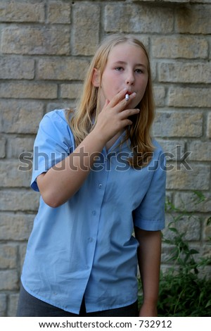 Social issues - First cigarette [note:- set up image using a stage prop cigarette] - stock photo