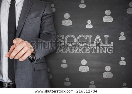 Social marketing on black blackboard with businessman - stock photo