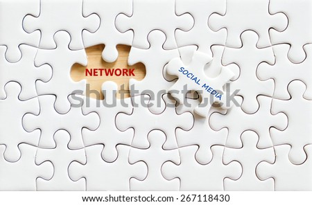 Social media and network words on jigsaw puzzle background, technology concept - stock photo