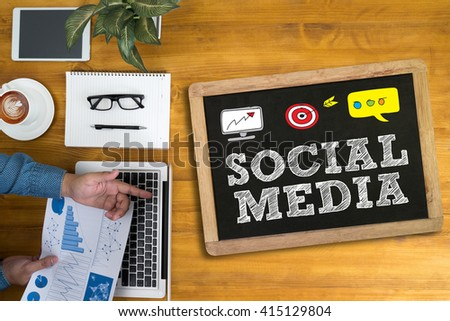 SOCIAL MEDIA Businessman working at office desk and using computer and objects, coffee, top view, - stock photo