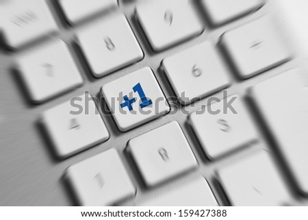 Social Media button on a keyboard showing the friend icon