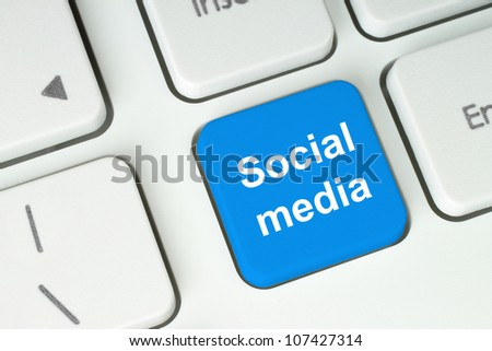 Social media button on keyboard - stock photo