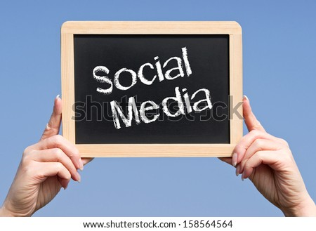 Social Media Chalkboard with Hands - stock photo
