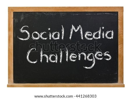 Social media challenges written in white chalk on a black chalkboard isolated on white