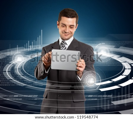 Social media concept, man businessman in suit with touch pad in his hands - stock photo
