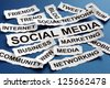 Social media concept torn newspaper headlines reading marketing, networking, community, internet etc - stock photo
