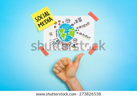 Social media connections, hashtags, news, share, like. Hand making thumb up gesture. - stock photo