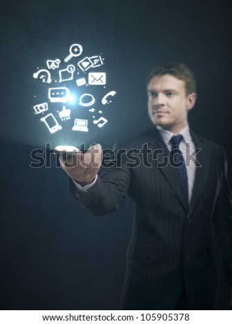 social media content in hand of businessman - stock photo