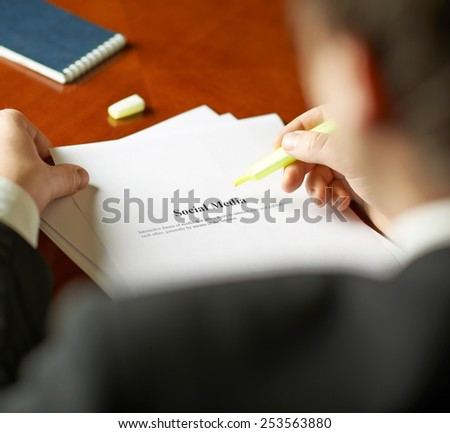 Social media definition as a shallow depth of field close-up composition of a man in a business suit working with the text