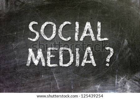 Social Media handwritten with white chalk on a blackboard. - stock photo