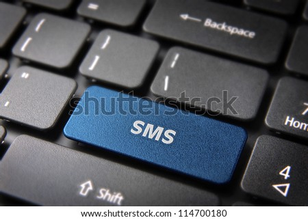 Social media key with SMS text on laptop keyboard. Included clipping path, so you can easily edit it. - stock photo