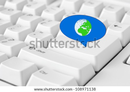 Social media key with world symbol in speech bubble sign on the keyboard - stock photo
