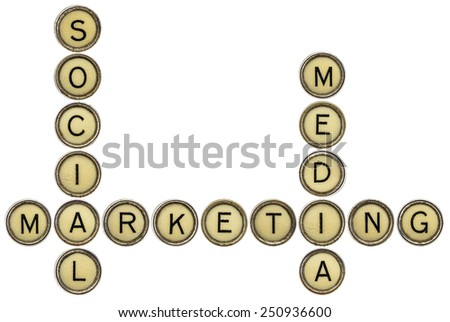 social media marketing - crossword  in old round typewriter keys isolated on white - stock photo