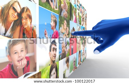 Social media network. Blue hand pointing at screen full of people, faces