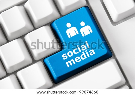 Social media text and people symbols on the modern keyboard. Concept - stock photo