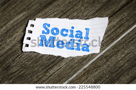 Social Media written on a paper on the wood background - stock photo