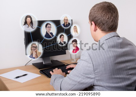 social network concept - business man using personal computer in office - stock photo