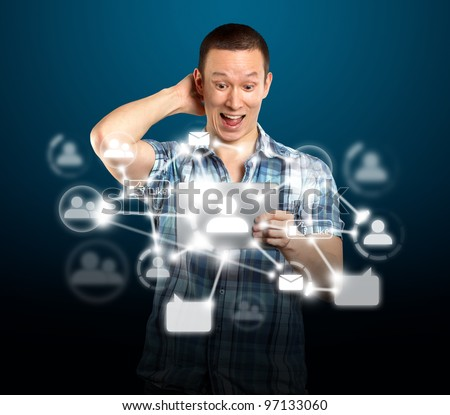 Social network concept, man with i pad in his hands