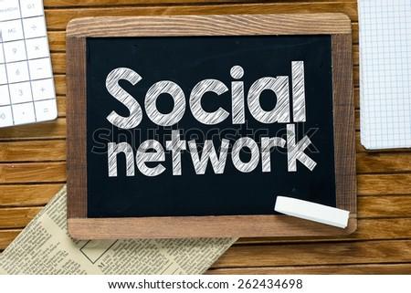 Social network handwritten on blackboard - stock photo
