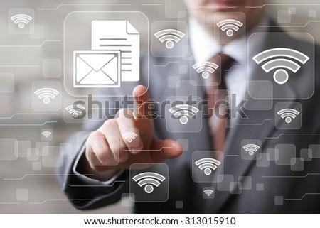 Social network Wifi businessman presses button file sign - stock photo