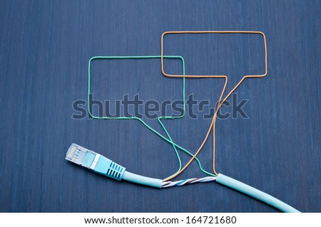 Social networking. Speaking bubbles made of ethernet cable - stock photo